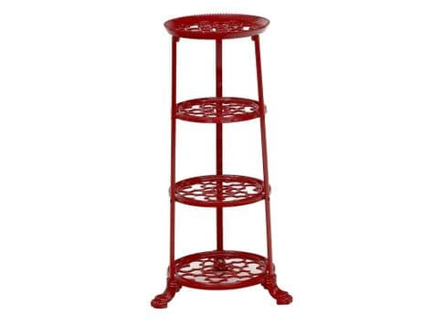 red saucepan tower   cast iron pot stand   plant stand