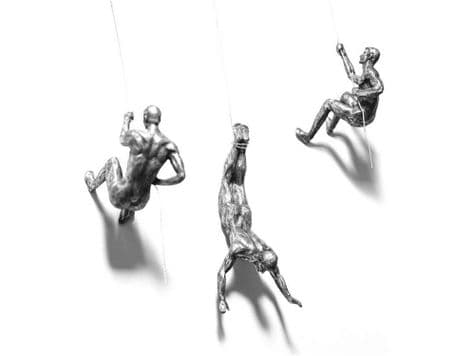 silver abseiling men   wall sculptures of men on wire