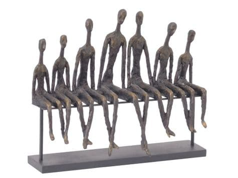 matchstick men sculpture | people sitting on bench