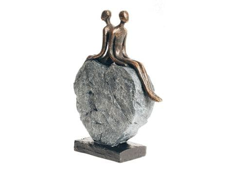 bronze lovers sculpture | couple on stone heart ornament